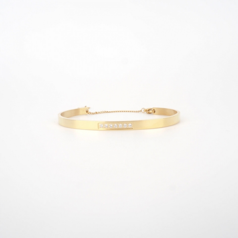 Sparkle chained gold bangle...