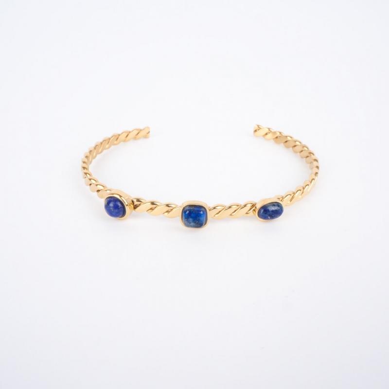 Gold steel 3 blue stones...