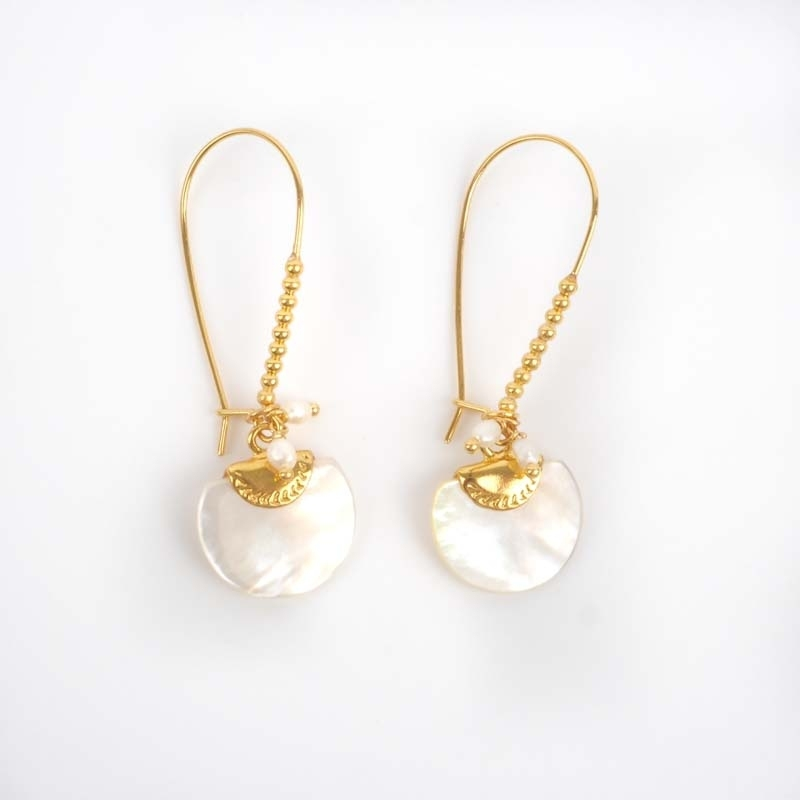 Gold earrings mother of...